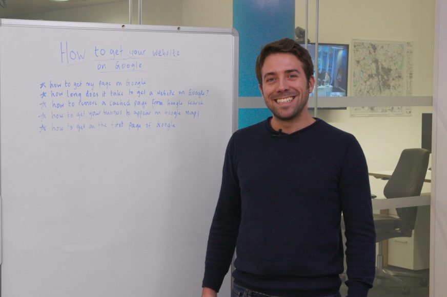 man stood in front of a white board