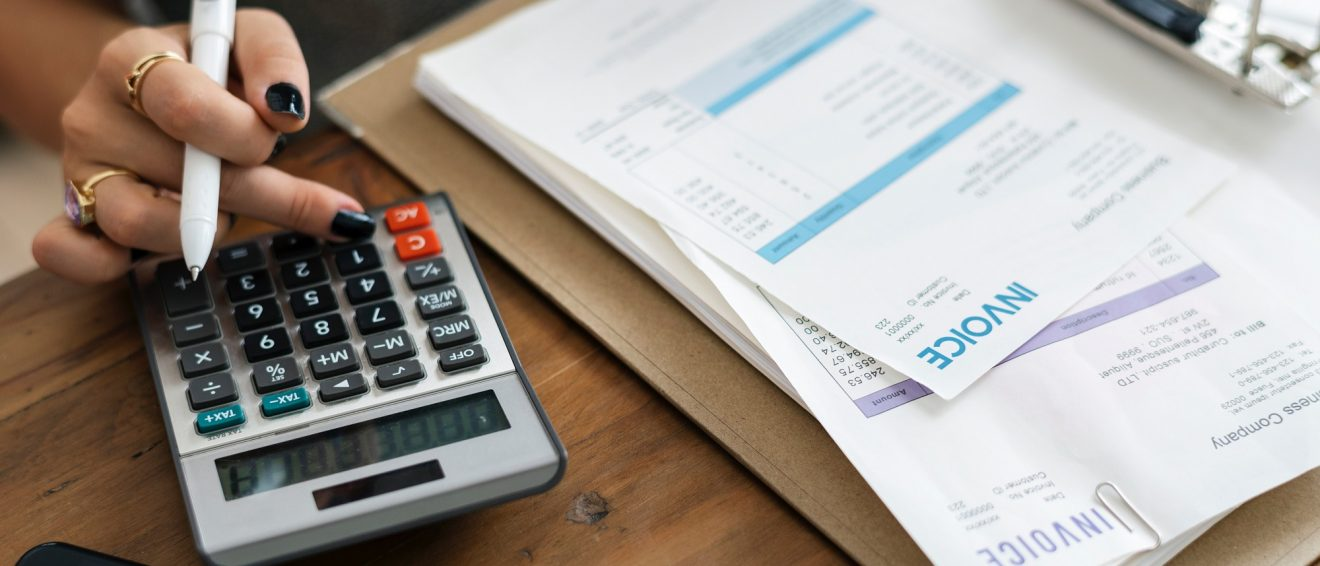 invoices on desk with calculator