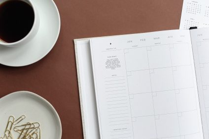 monthly planner on desk