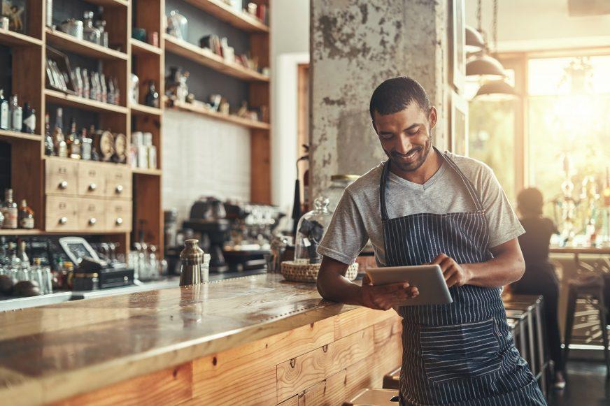 cafe owner using tablet